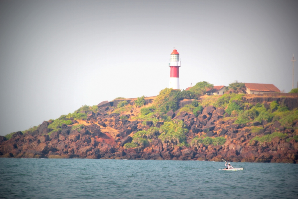 Paddling past the lighthouse